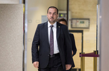 Hariri SNC head arrives for a round of negotiation during the Intra Syria talks, at the European headquarters of the U.N. in Geneva