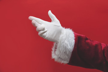 Santa Claus hand against a red background