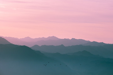 Poster Lichtroze Mountain range at sunrise light