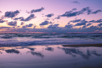 Beautiful beach in evening with reflection. The time after sunset