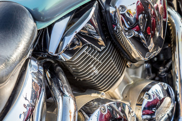 Chromed motorcycle parts on a sunny day