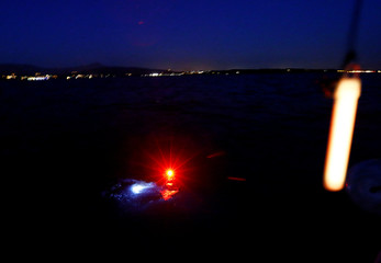 Lights are pictured on swimmer Gewert during their 70 km relay across Lake Leman from Montreux to Geneva near Yvoire