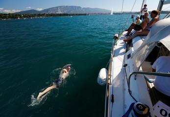 Swimmer Whitehead swims a 70 km relay across Lake Leman in Geneva