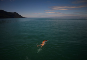 Naunton swims during her shift during their 70 km relay across Lake Leman from Montreux to Geneva, near St-Gingolph
