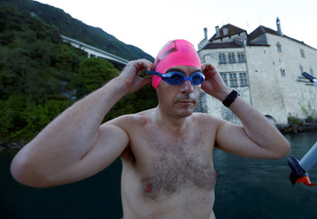 Swimmer Whitehead gets ready for the start of their 70 km relay swim across Lake Leman at the Chateau de Chillon in Veytaux