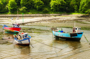 Small Fishing Boats in Harbour at Low Tide. Fishguard, Wales, UK.