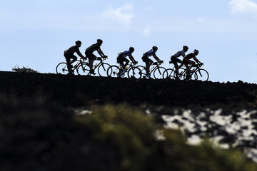 Cyclists in the peloton on the road to Lanzarote, Canary Islands.