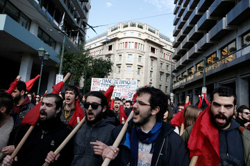 People shout slogans during a demonstration marking a 24-hour general strike against austerity in Athens