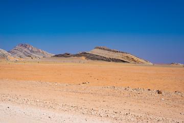 Road trip in the Namib desert, Namib Naukluft National Park, travel destination in Namibia. Travel adventures in Africa.