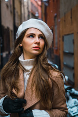 Attractive woman on snowy street