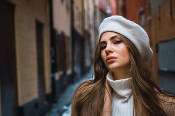 Attractive woman on snowy street