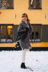 Pretty woman jumping on street