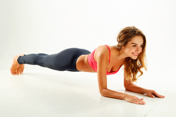 Young happy woman doing yoga. Wellness concept.