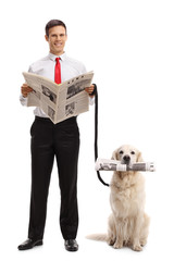 Elegant guy with a newspaper and a labrador retriever dog with a newspaper