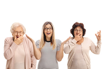 Two elderly women and a young woman making surprise gestures