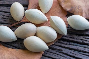 Ginkgo biloba (seeds) on the background wood.