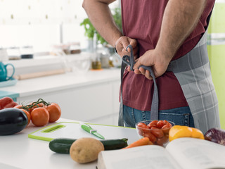 Cook tying his apron