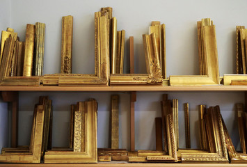 Gold-plated picture frame samples are on display at Arte Aurelia gold-plating workshop in Vienna
