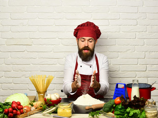 Chef prepares meal. Cooking process concept. Man with beard