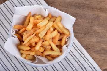 plate of french fries on wooden table