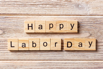 Happy Labor Day word written on wood block. Happy Labor Day text on table, concept