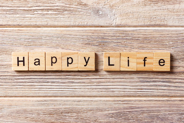 happy life word written on wood block. happy life text on table, concept
