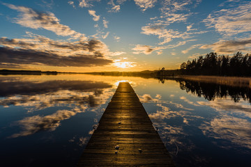 Sunset over a lake in Nykroppa, Filipstad, Sweden with a jetty