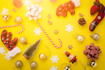 christmas and new year ideas concept with festive decorating items on yellow color plate background with free copy space for your creativity ideas text
