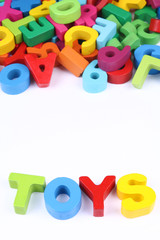 Colorful blocks of alphabets and numbers as toys for child development