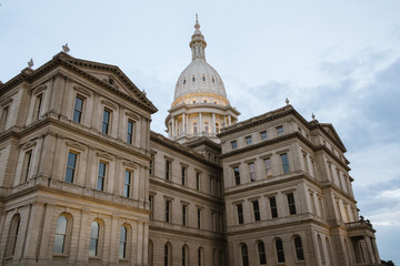 Lansing State Capitol Building in Michigan after a rainy day with the clouds still out. Another angle with more focus on the dome.