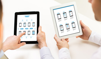 web designers with user interface on tablet pc