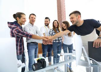 handshake colleagues in creative Studio