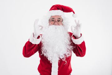 Portrait of a happy Santa cross on a white background, Winter holiday, Merry Christmas and happy new year concept