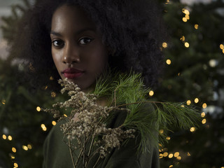 Festive portrait with soft glowing holiday lights