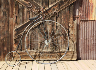 Old High Wheel Bicycle in Front of Whethered Barn Door