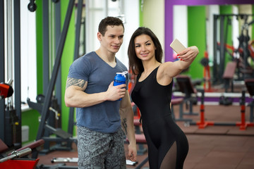 Young couple taking a sefie in a gym