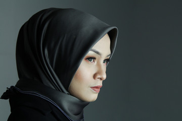 Portrait Muslim woman. Low key background, Woman Power Success concept