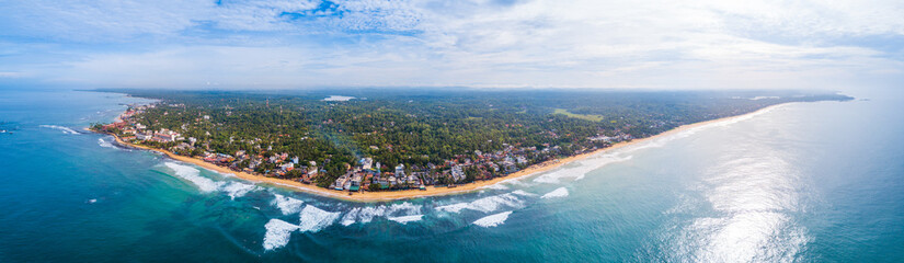 Fototapete - Aerial view of the town of Hikkaduwa with its beaches, surfspots and buildings. Sri Lanka