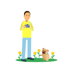 Young man character taking photo of his cute pug dog on a green lawn with flowers. Boy enjoys photography. Flat vector cartoon illustration