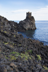 ancient watchtower in lava stone in Sicily