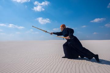 Expressive caucasian man is practicing martial arts