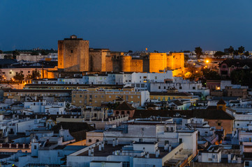 Illuminated castle in San Lucar de Barrameda, Spain