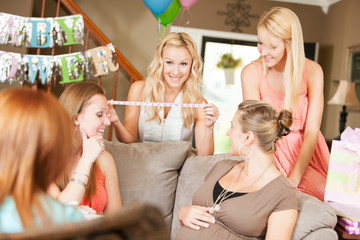 Baby Shower: Friends Playing Game to Guess Size of Mom's Belly