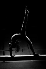Silhouetted Black Gymnast in Back Walkover