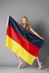 Beautiful woman wrapped in the German flag