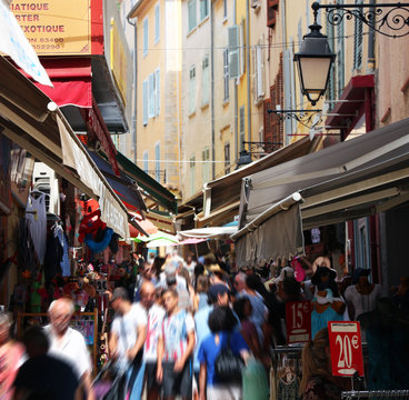 crowded shopping street in old town HYERES in southern France
