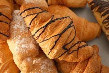 Delicious sweet croissants, closeup