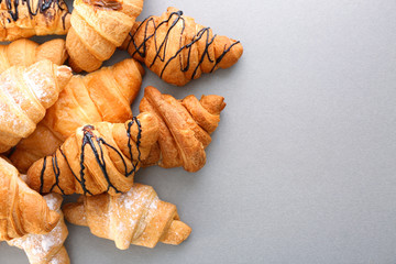 Delicious croissants on light background