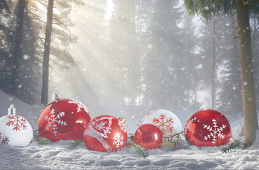 Christmas magic winter Scene. Red and white bubbles in snowy forest landscape.