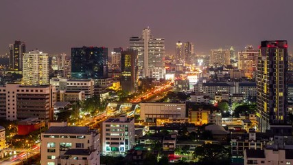 Fotomurales - Bangkok skyline with city traffic at evening. Time lapse